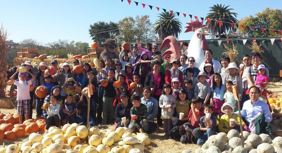 Group photo of visiting scholars at Pumpkin Patch