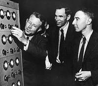 Men looking at circuit board